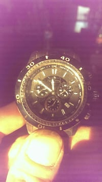 round black chronograph watch