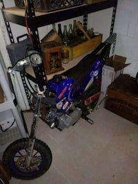 black and blue motocross dirt bike 38 mi