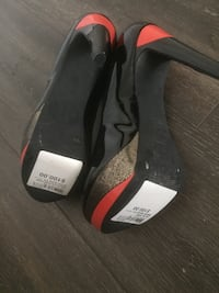 pair of black-and-red slide sandals Vancouver, V6C