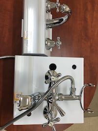two stainless steel faucets
