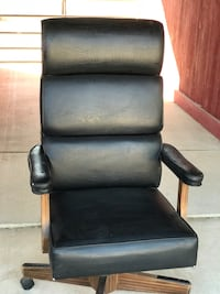 black leather padded rolling armchair Norco, 92860