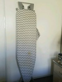 black and gray ironing board 2057 mi