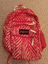 red and white Jansport backpack Mississauga, L5W 1E9