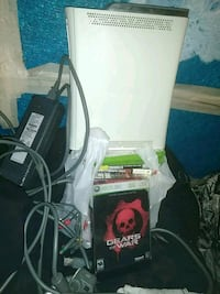 white Microsoft Xbox 360 with assorted game cases