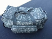 gray and green digital camouflage duffel bag