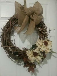 grapevine wreath with flower and ribbon-accent