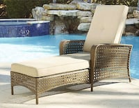 Outdoor Cosco wicker lounge with tan cushion 367 mi