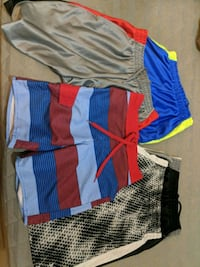Boys size 8 shorts and one swim short