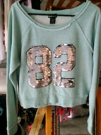 WET SEAL SZ.L MINT GREEN AND SILVER LOGO SWEATER Haines City, 33844