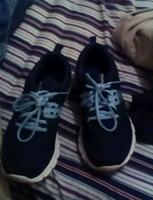 290f72e88489d0 Used pair of black-and-white running shoes for sale in Grand Prairie ...