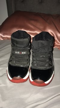 pair of black Air Jordan 11's North Lauderdale, 33068