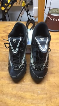 Pair of black-and-white Under Armour cleats Aiken, 29803