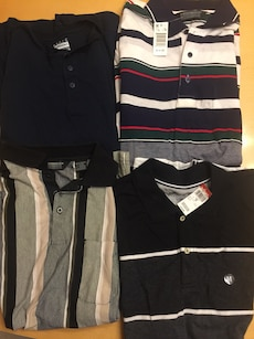 Four brand new medium assorted polo shirts