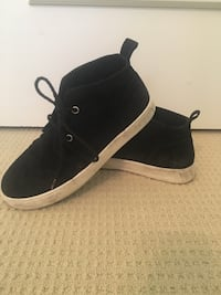 Pair of black-and-white high top sneakers size 7