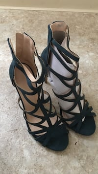 Pair of emerald green strappy open toe heels.