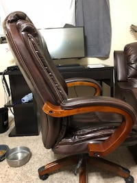 Brown wooden framed brown leather padded glider chair Tomball, 77377