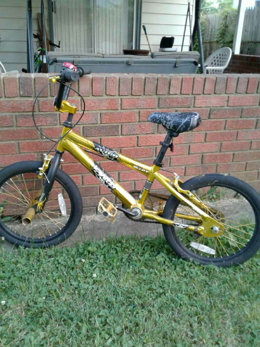 yellow and black BMX