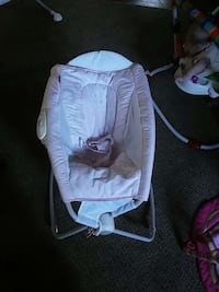 baby's pink and white rock and play sleeper