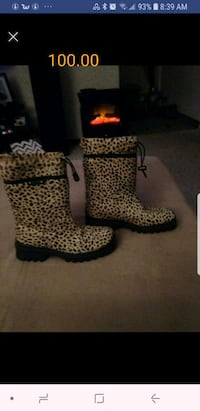 pair of brown-and-black leopard print boots 3159 km