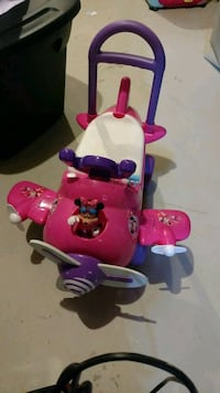 pink and white Minnie Mouse ride-on toy airplane