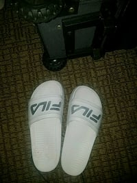 pair of white-and-black Nike slide sandals