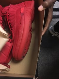 pair of red Nike basketball shoes Columbus, 43219