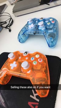 two blue and orange game controllers Milton, L9T