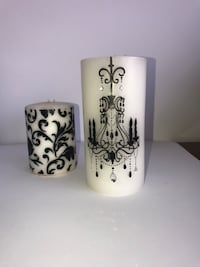 two white-and-black floral pillar candles 1304 mi