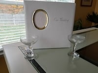 two clear wine glass with photo frame