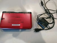 red Nintendo DS with charger Oakland, 94603