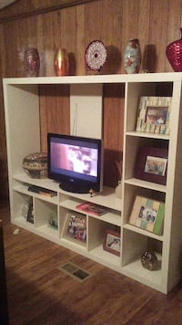 flat screen TV and white wooden hutch