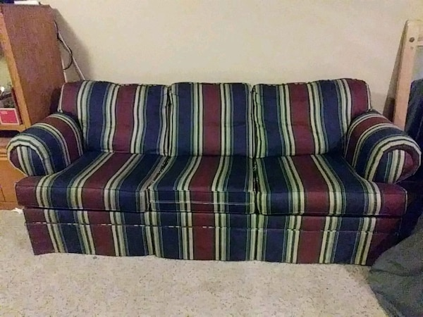blue, red, and white striped fabric sofa