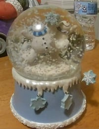 Christmas snow globe snowman plays Jingle Bells