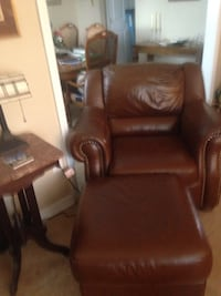 Leather brown chair and ottoman from Dillard's.Perfect condition Kenner, 70065