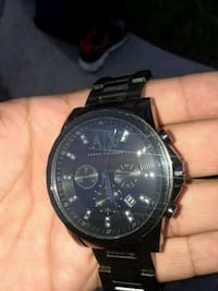 round black chronograph watch with black link brac Los Angeles, 91601