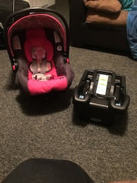 infant's pink and black carrier car seat with black car seat base Athens, 30601