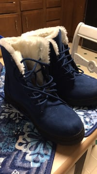 Pair of blue leather sheep skin boots
