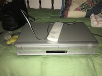 gray DVD player and vhs with remote controller