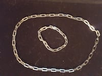 silver-colored chain link necklace and bracelet