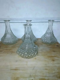 four clear cut glass decanters