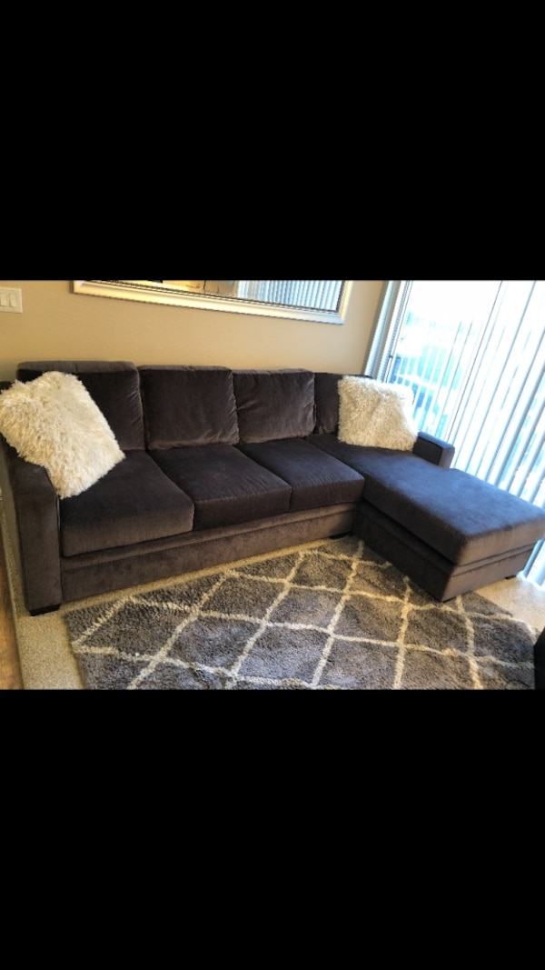 black fabric sectional sofa with throw pillows