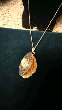 gold-colored pendant necklace Chico