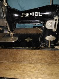 PREMIRE SEWING MACHINE IN TABLE