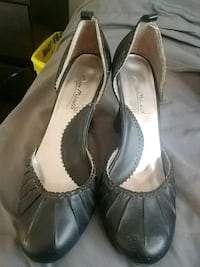 pair of black leather chunky heel sandals
