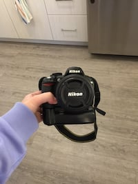 Nikon D3100 with 18-55mm lens, carrying case, battery grip