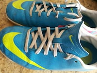 pair of teal-and-yellow Nike athletic shoes