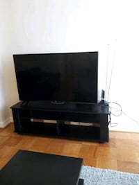 black flat screen TV; black wooden TV stand Alexandria, 22304