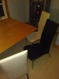 brown wooden table with chairs null