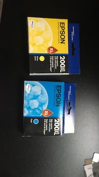 two Epson ink cartridges 3799 km