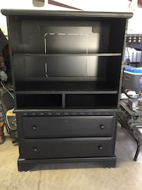 black wooden drawers and rack